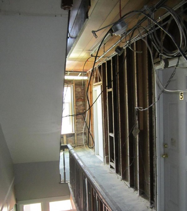 Residents of 193 Congress St. said building renovations began in early July, leaving exposed wires in hallways and apartments.