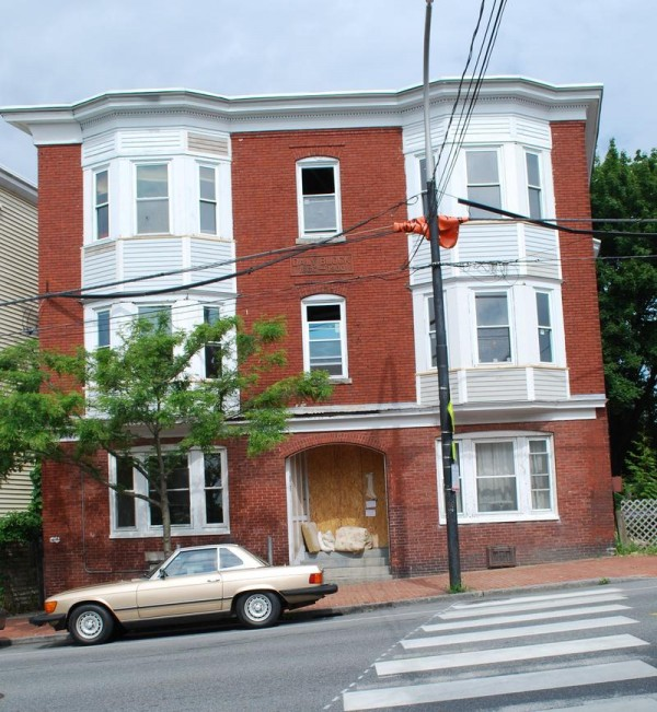 A 12-unit apartment building at 193 Congress St. remains boarded up Aug. 7, two days after city inspectors ordered power shut off because of electrical code violations that occurred during renovations.