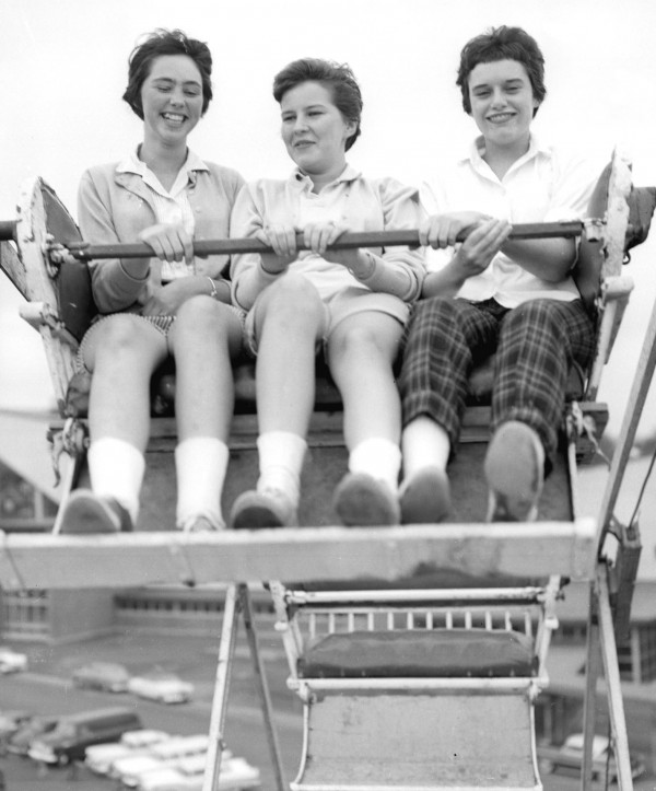 Carlene Davis, Mary Desprey and Norah Lee Golden, all of Bangor, ride the Ferris wheel at the 1957 edition of the Bangor State Fair. Youngsters found the rides a chance to give their lungs plenty of exercise.