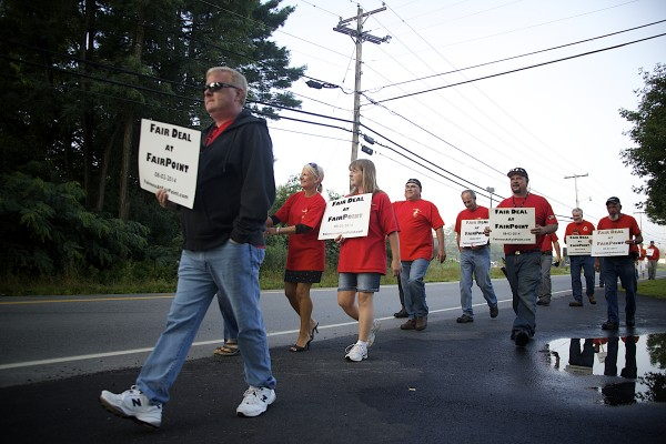 FairPoint employees conduct an informational picket a day before unions and the company meet for negotiations. The picketing is fueled by FairPoint's proposal to hire out-of-state contractors.