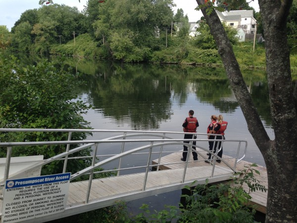 Firefighters from several communities launched boats Thursday morning to search the Presumpscot River for a man who was apparently swept over a dam.