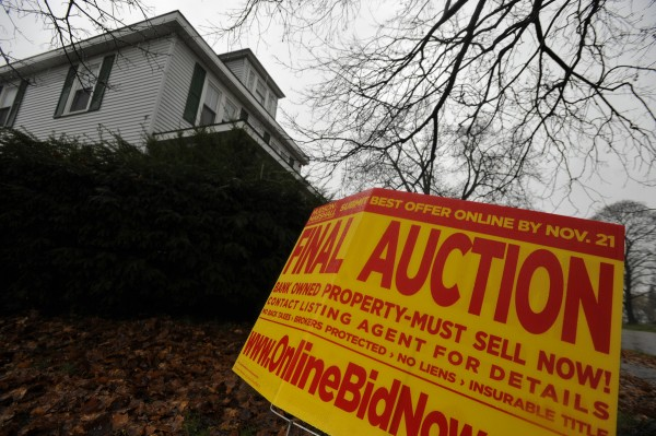 An auction sign in front of a home on Bangor's west side.