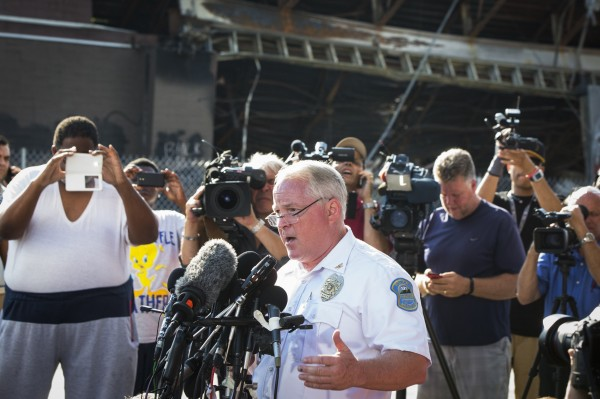 Ferguson Police Chief Thomas Jackson announces the name of the officer involved in the shooting of Michael Brown as officer Darren Wilson, in Ferguson, Missouri August 15, 2014. The briefing was held near a QuikTrip convenience store that had been burned amid protests over the shooting of Brown, 18, last Saturday.