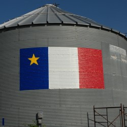 Bouchard Family Farms has their Acadian on with this giant duct-tape flag creation in Fort Kent.