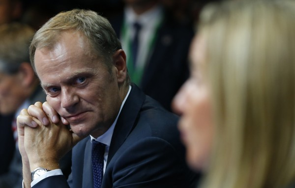 Newly elected European Council President Donald Tusk (left) of Poland and newly elected European High Representative for Foreign Affairs Federica Mogherini (right) of Italy attend a news conference Saturday during an EU summit in Brussels.