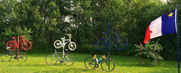 Near Long Lake in Madawaska, vintage bicycles were painted in the theme of the tri-colored Acadian flag in time for the World Acadian Congress.