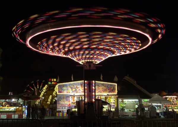 The swings ride at the Bangor State Fair becomes a whirl of color against a night sky