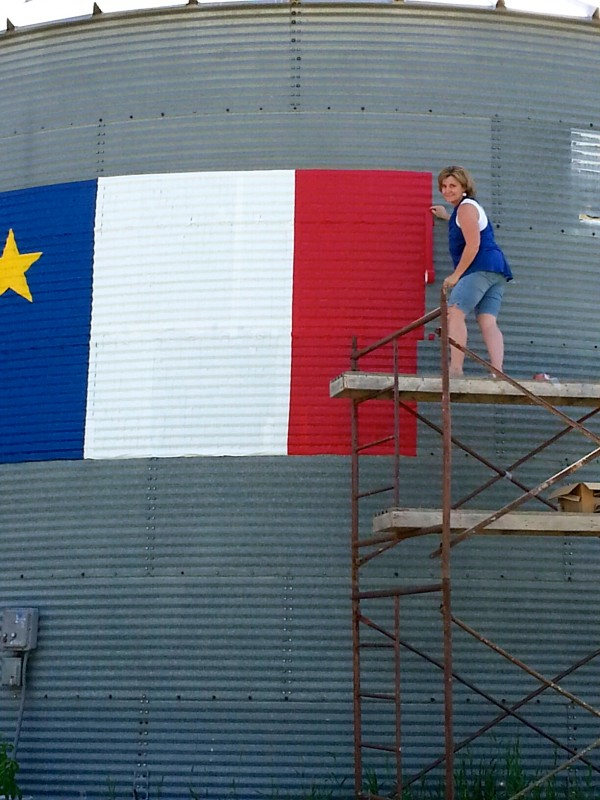 It took Janice Bouchard 10 hours and 12 rolls of duct tape to create this massive Acadian flag on her farm's grain silo in Fort Kent.