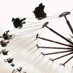 People ride the swings at the Bangor State Fair