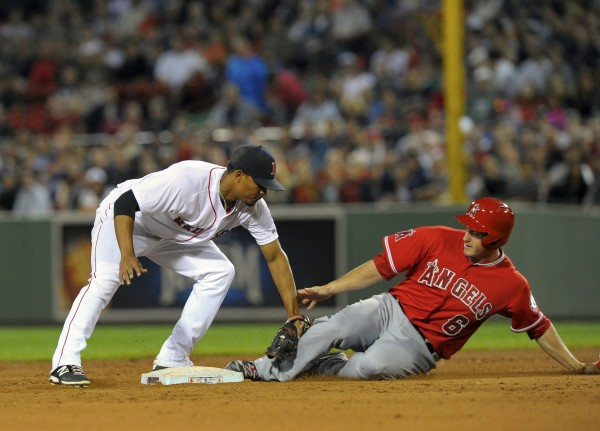 Los Angeles Angels third baseman David Freese (right) is tagged out by Boston Red Sox shortstop Xander Bogaerts on Monday at Fenway Park in Boston.