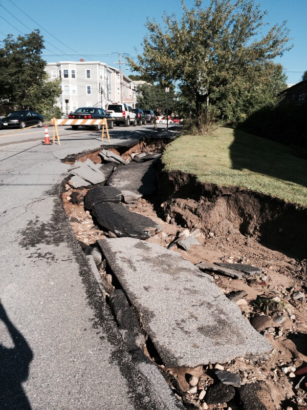 Torrential rains on Wednesday night left part of the roadway on Portland's High Street washed out near its intersection with Commercial Street on Thursday morning