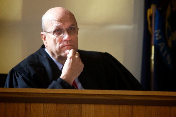 Justice Roland A. Cole listens to arguments in the case of prominent Waldoboro defense attorney Philip S. Cohen, who is charged with violating a plea agreement stemming from a domestic violence charge, agreed to surrender his passport in Superior Court in Augusta on Tuesday. An October 1 hearing was scheduled to consider revoking Cohen's bail and terminating the plea.