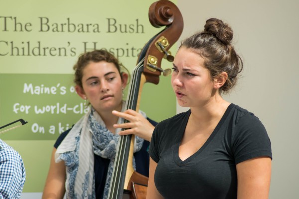 Lena Rich (front) sings alone as Samantha Pierce (back) keeps the rhythm on her stand-up bass.