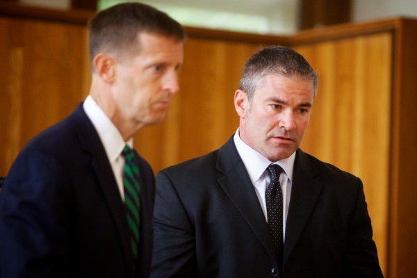 Defense attorney Walter McKee (left) walks his client Philip S. Cohen out of Superior Court in Augusta on Tuesday. Cohen is charged with violating a plea agreement stemming from a domestic violence charge. An October 1 hearing was scheduled to consider revoking Cohen's bail and terminating the plea agreement.