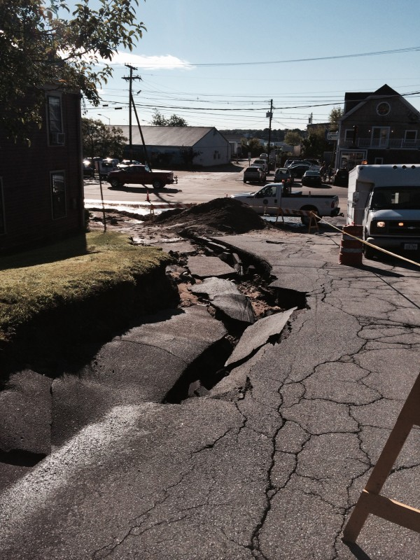 Torrential rains on Wednesday night left part of the roadway on Portland's High Street washed out near its intersection with Commercial Street on Thursday morning.