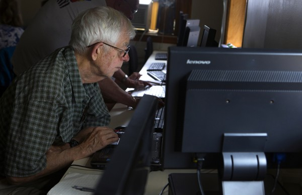 Mel McClure reads his email during a class to help senior citizens with social media and computers Thursday at the Hammond Street Senior Center in Bangor.