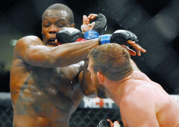 Ryan Bader (right) lands a punch on Ovince Saint Preux during the UFC fights at the Cross Insurance Center in Bangor Saturday night. Bader went on to win the fight.