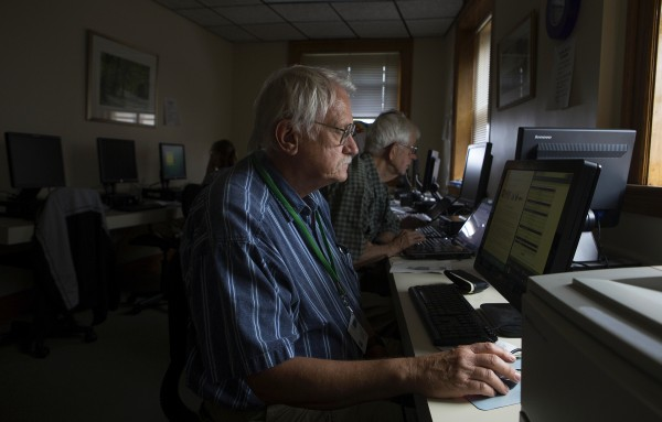 John Merrill fills out an online form for a deer license during a class to help senior citizens use social media and computers Thursday at the Hammond Street Senior Center in Bangor.