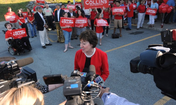 Senator Susan Collins talks to members of the media at her campaign headquarters in Bangor, before embarking on her cross-state bus tour Tuesday.