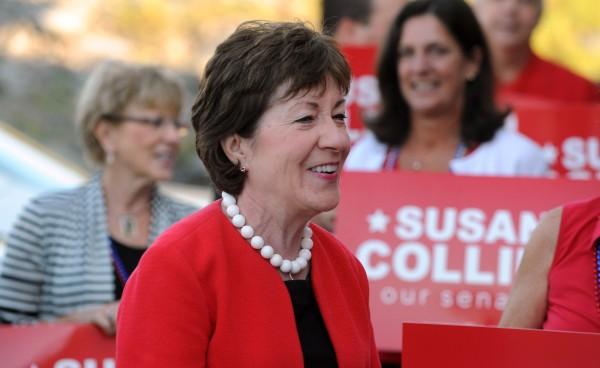Senator Susan Collins talks to supporters at her campaign headquarters in Bangor before embarking on her cross-state bus tour Tuesday.