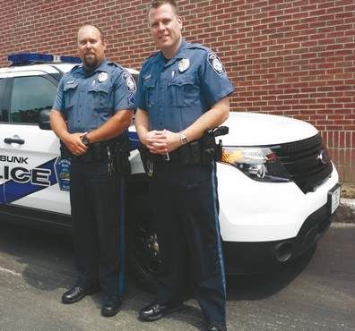 Kennebunk police officers Michael Tucci and Matthew Harrington saved the life of a Kennebunk resident after a traffic stop last Saturday.