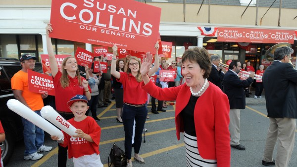 Senator Susan Collins waves to supporters as she leaves her campaign headquarters in Bangor to embark on her cross-state bus tour Tuesday.