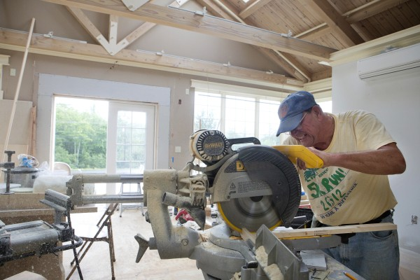 Joe Cyr cuts a piece of board at Sarah's House in Holden on Wednesday. The former Fox Run Furniture building on US 1A is being converted into housing for families of cancer victims from outside the area as a place to stay while they or their loved ones are undergoing treatment in Bangor-Brewer.