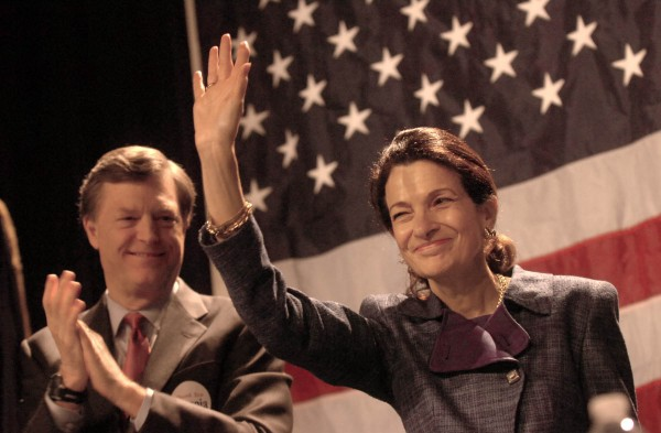 Former U.S. Sen. Olympia Snowe waves to her many supporters after delivering her speech at the Maine GOP Convention at the Augusta Civic Center in this May 2012 file photo. Behind her is her husband, former Maine Gov. John McKernan.