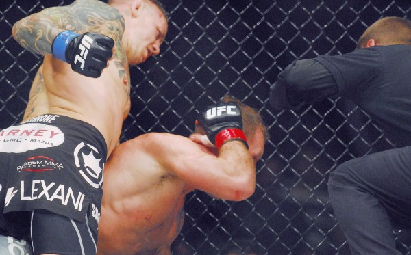 Lightweight fighter Ross Pearson (left) finishes off Gary Maynard during the UFC fights at the Cross Insurance Center in Bangor Saturday night.