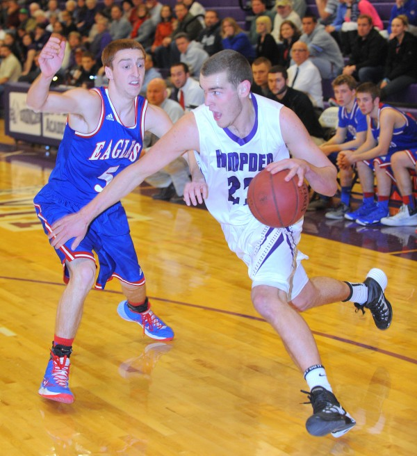 Hampden Academy's Zach Gilpin (right) drives past Messalonskee High School's  Jordan Greenleaf during a boys basketball game in Hampden in this January 2014 file photo.