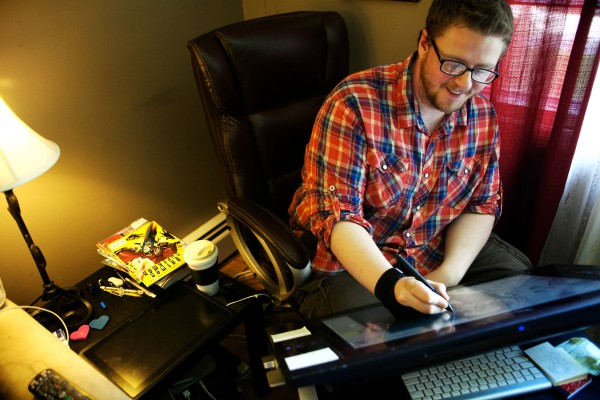 Comic book artist and creator Ray Dillon draws on a Cintiq computer screen at his home in Cape Elizabeth on Monday. Dillon, who has worked on major comics for big companies in the past, is crowdsourcing five original books of his own through the website Patreon.