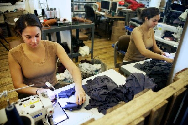 Lisa Strycharz sews clothing at Suger in Biddeford on Tuesday. The boutique features the work of designer Roxi Suger.