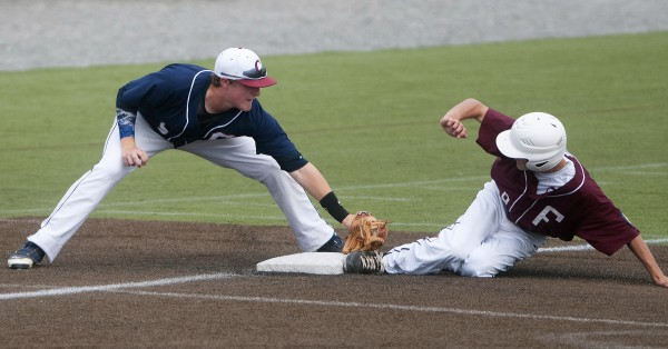 Brewer's Greg Warmuth (right) slides safely to third past Bangor's Andrew Hillier during their American Legion state baseball tournament game Saturday at Husson University.