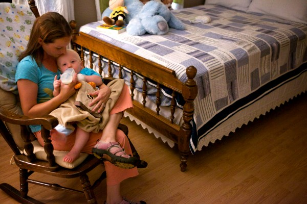Katie Bilodeau gives her 11-month-old son Carter a bottle before he takes an afternoon nap at their house in Gray on Friday. Bilodeau and her husband Chad follow napping routine advice from child sleep consultant Jessica Begley.