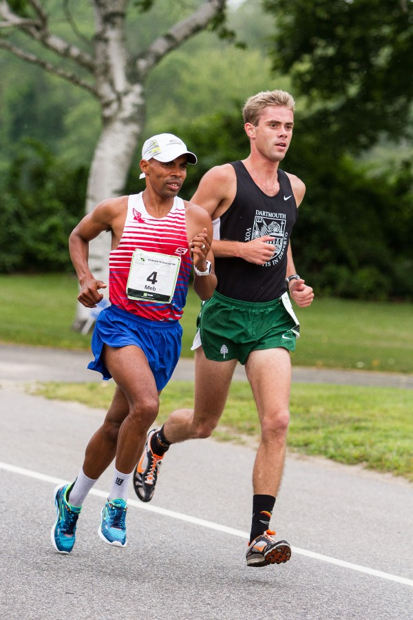 Will Geoghegan (right) and Meb Keflezighi race in the TD Beach to Beacon 10K on Saturday afternoon in Cape Elizabeth. Geoghegan of Brunswick, a former Dartmouth College running standout, won the Maine resident men's title for the first time, placing 16th overall among the field of more than 6,000 runners with a time of 29:53.0.