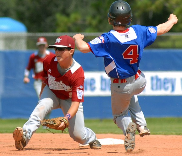 Canada's Austin Dundas safely makes it by Maine's Jesse Colford at second base during the fourth inning of the first Senior League World Series game at Mansfield Stadium on Sunday.