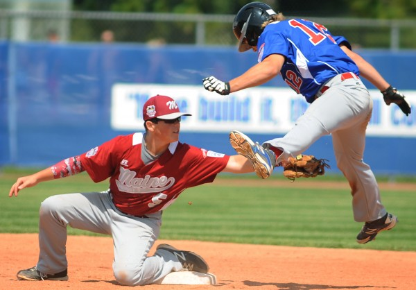 Maine's Jesse Colford tags out Canada's Jake Hesselink at second base in the seventh inning of their Senior League World Series game on Sunday afternoon at Mansfield Stadium.  Maine District 3 won 7-2.