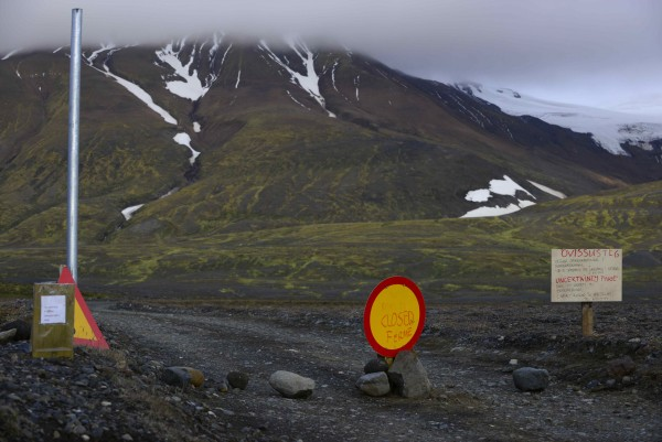 Warning signs block the road to Bardarbunga volcano, some 12.5 miles away, in the north-west region of the Vatnajokull glacier August 19, 2014.
