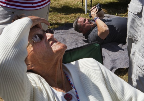 Gov. Paul LePage (right) and Rita DeRosby search the skies for wife and daughter, Ann LePage, who jumped out of an airplane with the All Veteran Parachute team Saturday as part of the Freedom Fest in Fort Kent.