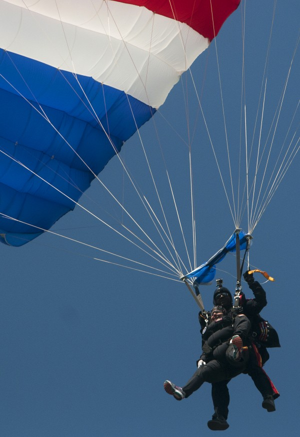 Ann LePage (left) and All Veteran Parachute team member Tony Mouzon parachute back to earth Saturday as part of the Freedom Fest in Fort Kent.