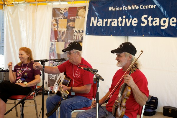 Pauleena MacDougall, director of the Maine Folklife Center (from left) Harold Jackson and Martin &quotMark&quot Morris share the Narrative Stage at the 2013 American Folk Festival in Bangor.