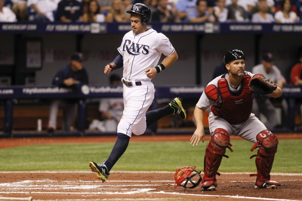 Evan Longoria of the Tampa Bay Rays scores on a double by James Loney in the second inning against the Boston Red Sox at Tropicana Field in St. Petersburg, Fla., on Saturday.