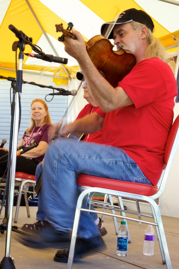 Martin &quotMark&quot Morris of St. Francis plays the fiddle while keeping time with his feet in the French-Canadian tradition at the 2013 American Folk Festival on the Maine Folklife Center stage. Morris learned to play the fiddle by ear from old-time fiddlers in the St. John Valley including Simon St. Pierre.