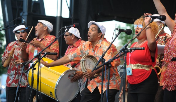 Jorge Arce and Raiz de Plena entertain the crowd at the Railroad stage at the 2013 American Folk Festival.
