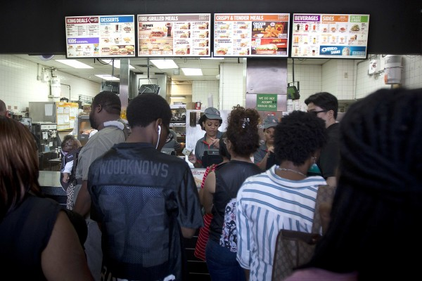 People line up at lunchtime at a Burger King in Brooklyn on Monday.