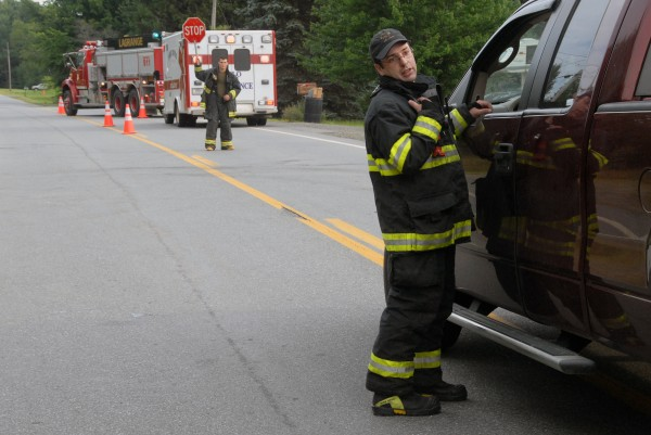 LaGrange Assistant Fire Chief Mike Bacon stops a vehicle near 5572 Bennoch Road in LaGrange on Sunday, Aug. 3, 2014. It was one of two places where firefighters or police had traffic stopped on in response to a police standoff with an armed man.