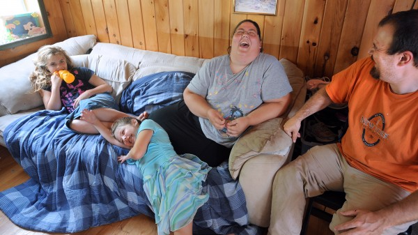 Sisters Julieanna (left) and Brianna Spaulding (second left) share a laugh with their mother, Shanna Grindle, and stepfather, Gregg Grindle.