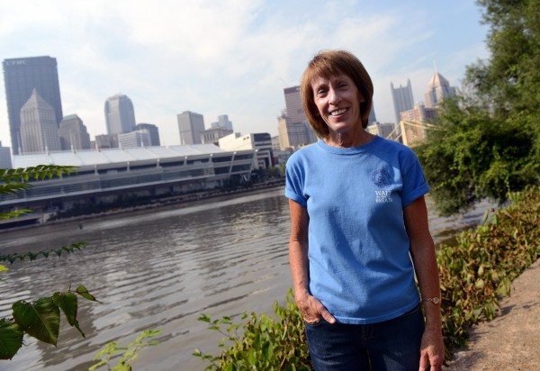 Tami Rippy, event organizer of the Violet Rippy 5K Run/Walk for Pulmonary fibrosis — in honor of her mother — along the event route along Pittsburgh's North Shore Trail on August 1, 2014.
