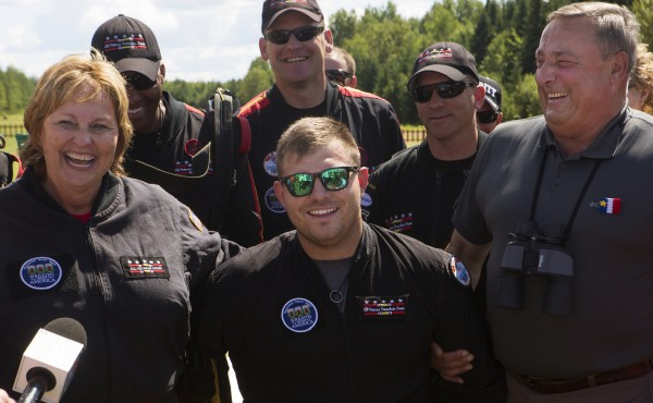 Ann LePage (from left), Travis Mills and Gov. Paul LePage laugh after Mills and the first lady successfully parachuted with the All Veteran Parachute team Saturday as part of the Freedom Fest in Fort Kent.