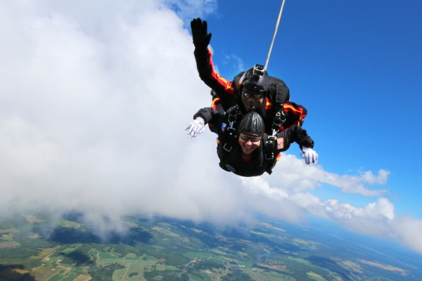 Ann LePage (bottom) and All Veteran Parachute team member Tony Mouzon parachute back to earth Saturday as part of the Freedom Fest in Fort Kent.